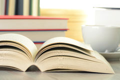 Composition with books and cup of coffee Stock Image