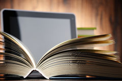 Composition with books and tablet computer Stock Photos