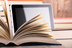 Composition with books and tablet computer on the table Royalty Free Stock Images