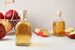 Composition with bottle of apple vinegar on table. Space for text royalty free stock photos