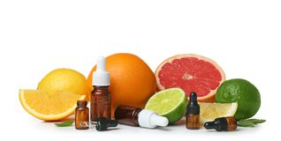 Composition with bottles of citrus essential oils. On white background stock photography