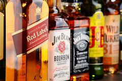 Composition with bottles of popular whiskey brands Royalty Free Stock Images