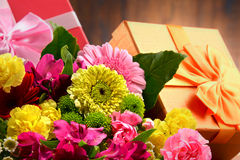 Composition with bouquet of flowers and gift boxes Stock Photos