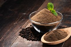 Composition with bowl of ground black pepper on wooden table Stock Photography