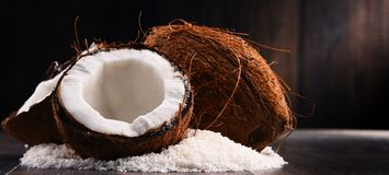 Composition with bowl of shredded coconut and shells Royalty Free Stock Photography
