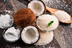 Composition with bowl of shredded coconut and shells Stock Photo
