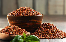 Composition with bowl of sorgo grain.  Royalty Free Stock Photography