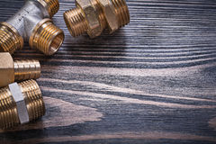 Composition of brass connectors on wooden background plumbing co Stock Photography