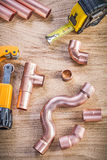 Composition of brass water pipe cutter fittings tape measure on Stock Images