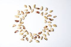 Composition with Brazil nuts and space for text on white background. Top view stock photos