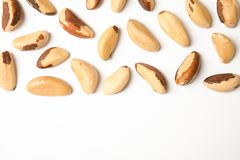 Composition with Brazil nuts on white background, top view. Composition with Brazil nuts and space for text on white background, top view royalty free stock photography