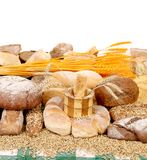 Composition of bread and golden ears. Stock Photo