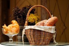 Composition. With bread and rolls in wicker basket Stock Image
