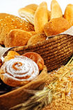 Composition with bread and rolls in wicker basket, combination of pastries for bakery or market Royalty Free Stock Image