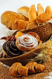 Composition with bread and rolls in wicker basket, combination of sweet pastries for bakery or market Royalty Free Stock Photography
