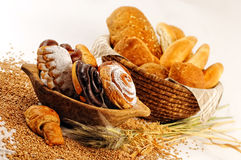 Composition with bread and rolls in wicker basket, combination of sweet pastries for bakery or market Stock Photo