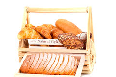Composition with bread and rolls in wicker basket isolated Royalty Free Stock Image