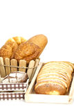 Composition with bread and rolls in wicker basket isolated Stock Image