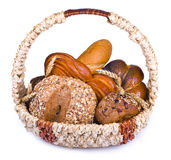 Composition of bread and rolls in wicker basket Stock Photos