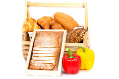 Composition with bread and rolls in wicker basket isolated Stock Photo
