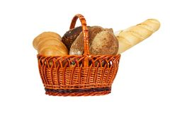 Composition with bread and rolls in wicker basket isolated on white royalty free stock image