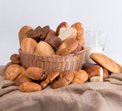 Composition of bread and rolls in a wicker basket royalty free stock images