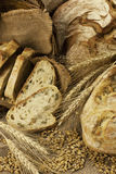Composition with bread  in wicker basket isolated on white Stock Images