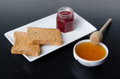 Composition of breakfast, honey, toasts,jam Stock Photos