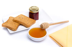 Composition of breakfast, honey, toasts,jam Royalty Free Stock Image