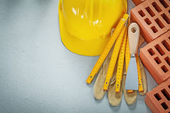 Composition of bricklaying tools on concrete background construc Stock Photo