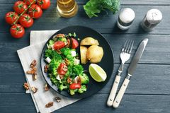 Composition with broccoli salad. On wooden background stock photo