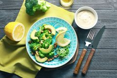 Composition with broccoli salad. On wooden background stock photography