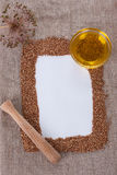 The composition of buckwheat and sunflower oil. Frame made of buckwheat on canvas Stock Photo