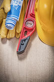 Composition of building tools on wooden board construction conce Royalty Free Stock Images