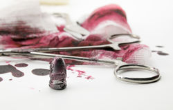Composition with bullet, blood and bandage Royalty Free Stock Photo