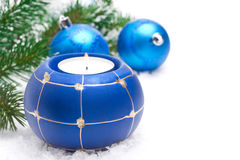 Composition with burning candle and blue Christmas balls Royalty Free Stock Images