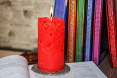 Composition of the burning red openwork handmade candles among c Stock Images