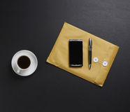 A composition of business elements - phone, pen, envelope Royalty Free Stock Photography