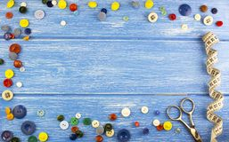 Composition of buttons on a blue wooden background buttons stock photos