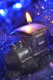 Composition of a candle and tinsel Stock Image