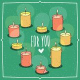 Composition with candles in heart shape. Composition with soft pink and yellow burning scented candles in heart shape.  green background. Cartoon hand draw style Stock Image