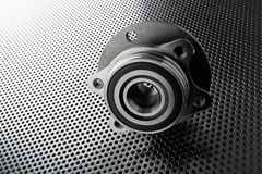 Composition of the car wheel bearing on metal surface. Selective focus royalty free stock images