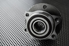 Composition of the car wheel bearing on metal surface. Selective focus stock photos