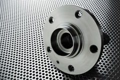 Composition of the car wheel bearing on metal surface. Selective focus stock photography