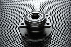 Composition of the car wheel bearing on metal surface. Selective focus stock photo