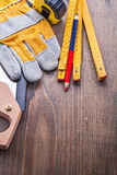 Composition of carpentry tools handsw glove Stock Image