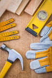 Composition of carpentry tools on wooden boards Royalty Free Stock Images