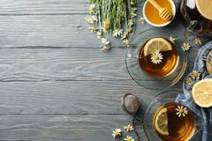 Free Composition Chamomile Tea On Gray Wooden Background Stock Photography - 187027322