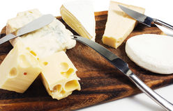 Composition of cheese. On cutting board Stock Photos