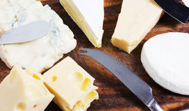Composition of cheese. On cutting board Royalty Free Stock Photography